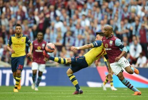 epa04776136 Arsenal's Mesut Oezil (L) vies for the ball with Aston Villa's Fabian Delph (R) during the FA Cup final soccer match between Arsenal and Aston Villa at Wembley stadium in London, Britain, 30 May 2015.  EPA/ANDY RAIN DataCo terms and conditions apply. http://www.epa.eu/files/Terms%20and%20Conditions/DataCo_Terms_and_Conditions.pdf