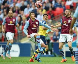 epa04776139 Aston Villa's Ashley Westwood (2-L) vies for the ball with Arsenal's Alexis Sanchez (2-R) during the FA Cup final soccer match between Arsenal and Aston Villa at Wembley stadium in London, Britain, 30 May 2015.  EPA/ANDY RAIN DataCo terms and conditions apply. http://www.epa.eu/files/Terms%20and%20Conditions/DataCo_Terms_and_Conditions.pdf